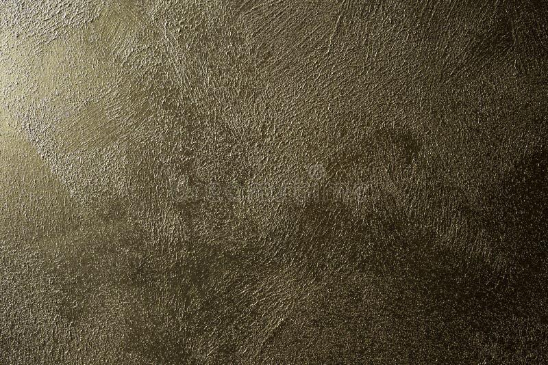 Diseño retro del color brillante marrón del oro de la textura del muro de cemento del Grunge imágenes de archivo libres de regalías