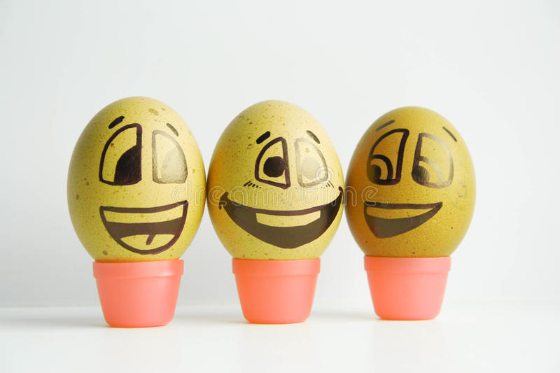 Disease. The concept of contagious diseases. Green with anger. Prize places. Competition. Photo - illustration for design. Eggs with painted face. Horizontal royalty free stock photo