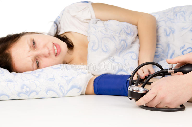 Download The Diseased Beautiful Girl Lying On The Bed, And Measure The Pr Stock Image - Image: 28156461