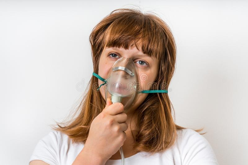 Diseased female patient with oxygen mask royalty free stock image