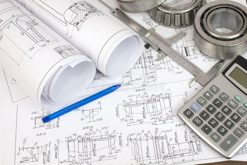 Disegni di costruzione. Ingegnere dello scrittorio fotografie stock