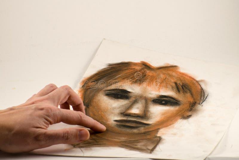 Disegno dalla matita sanguigna e dal carboncino Ritratto di un uomo fotografia stock libera da diritti