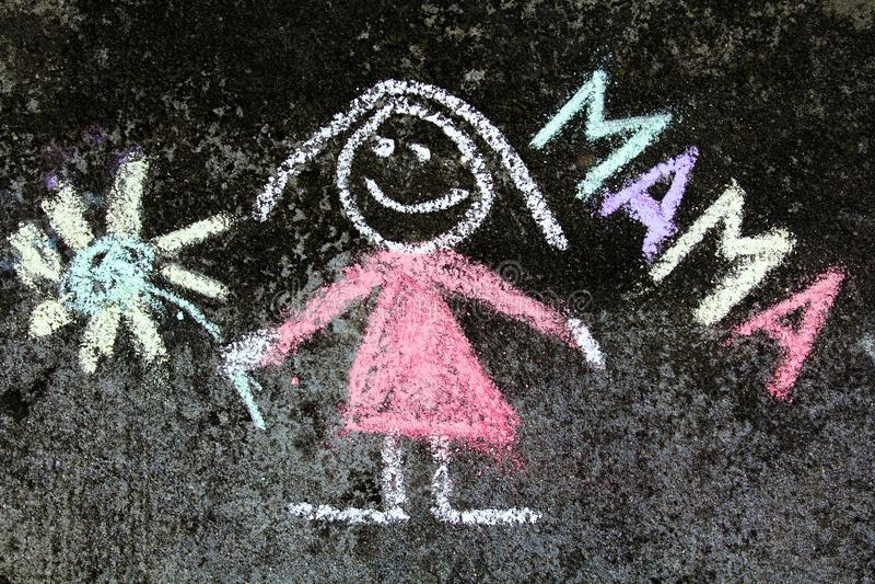 Disegno di gesso: ritratto della madre e parola MAMMA fotografie stock