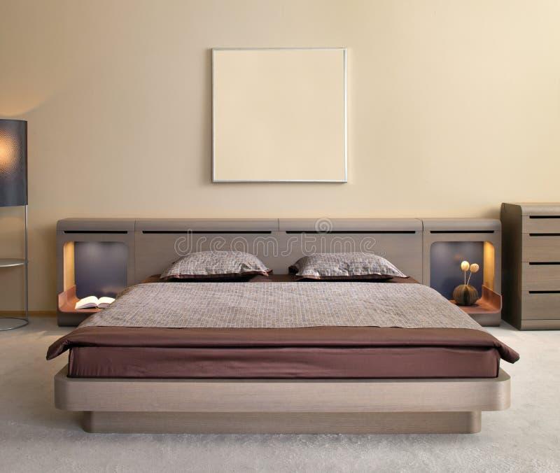 Disegno interno della bella e camera da letto moderna. immagini stock