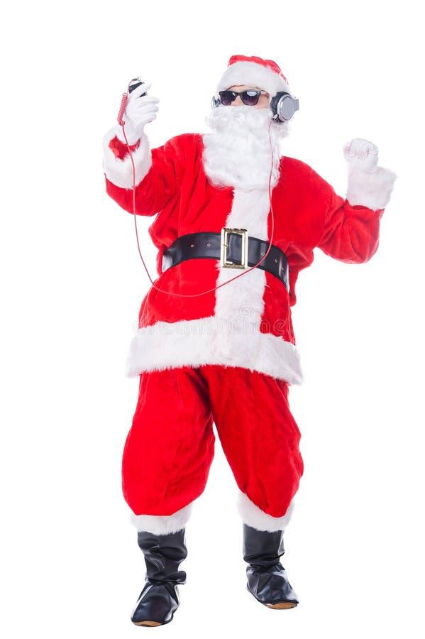 Disfrutar de música de la Navidad foto de archivo libre de regalías