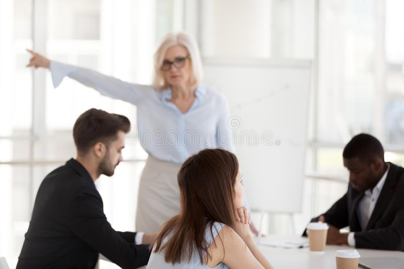 Disgruntled employee ignoring mature angry executive asking to l stock photo