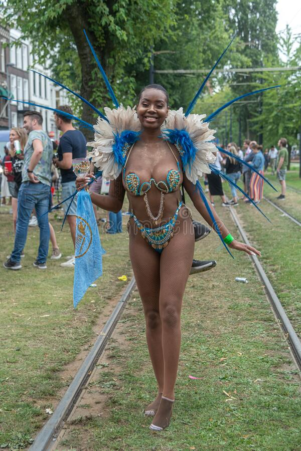 Free Disguised African Girl Smoking Weed At The Rotterdam Festival 2019 Royalty Free Stock Photos - 200034528
