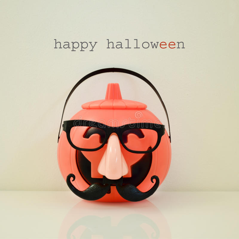Disguised carved pumpkin and text happy halloween stock photo