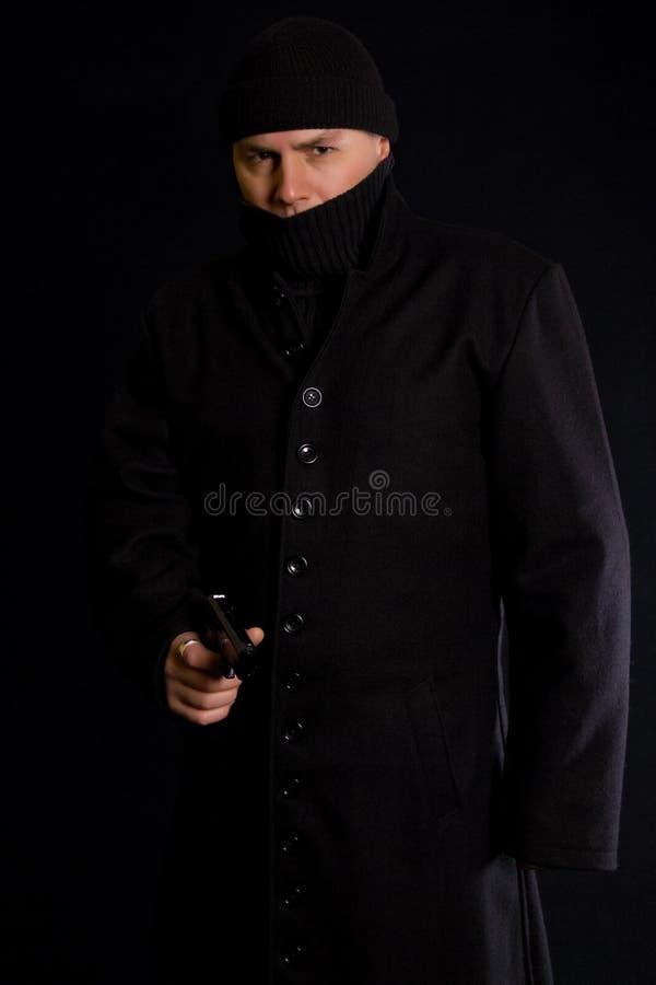 Disguised Gunman stock photos