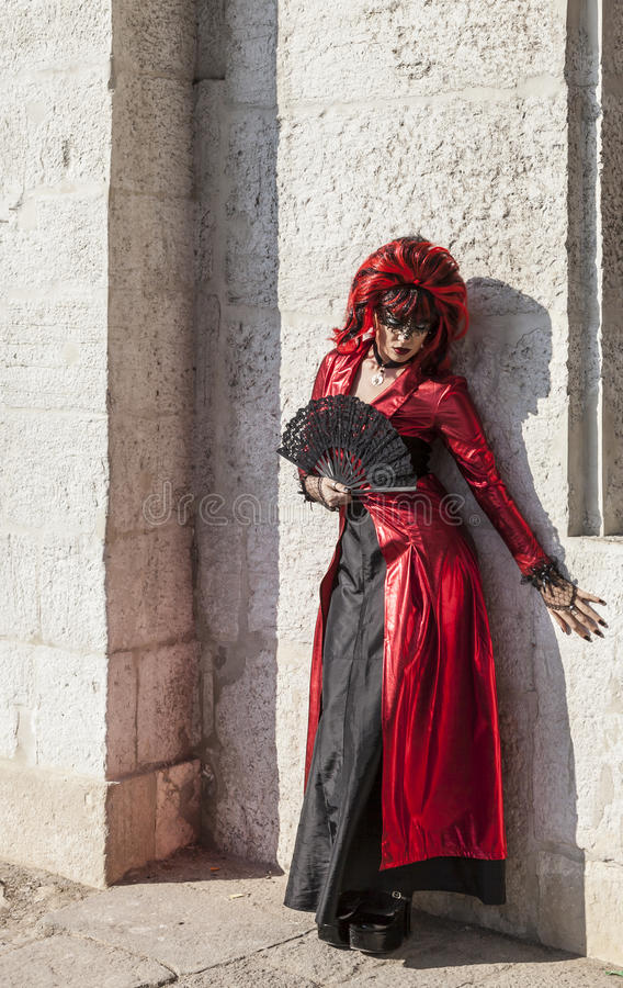 Disguised Woman with a Fan - Venice Carnival 2012 stock photo