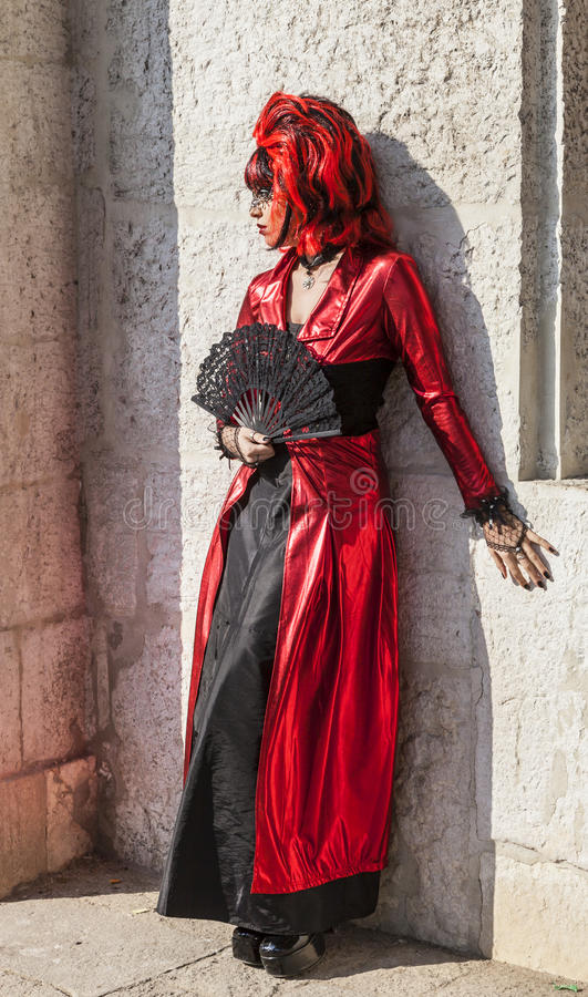 Disguised Woman with a Fan - Venice Carnival 2012 royalty free stock photo