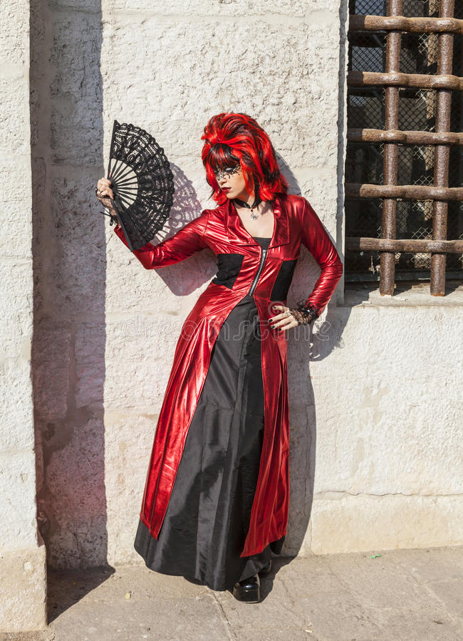 Disguised Woman with a Fan - Venice Carnival 2012 stock photography