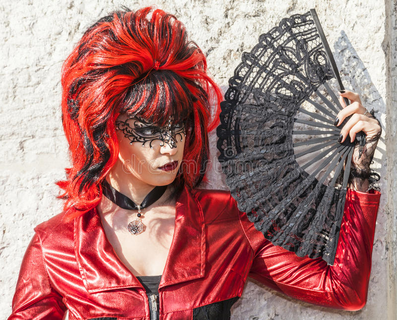Disguised Woman with a Fan - Venice Carnival 2012 royalty free stock image