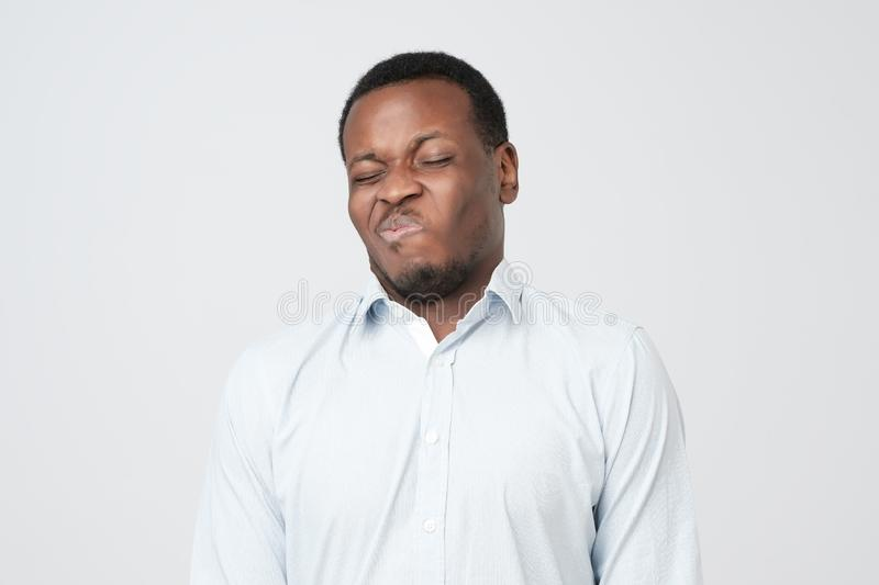 Disgusted young african american male looking in contempt, feeling loathing and disgust royalty free stock photography