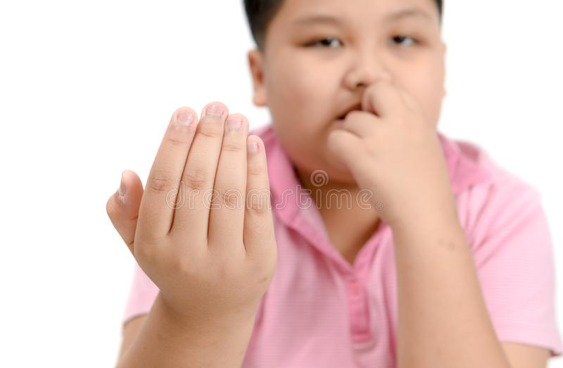 Disgusting bitten fingernails on boy`s hand isolated stock image