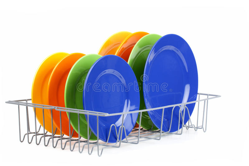 Dish. Color dish in plate rack royalty free stock photo