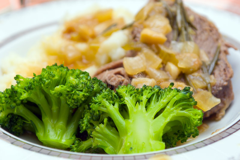 Dish. Meat with broccoli and onion royalty free stock photo