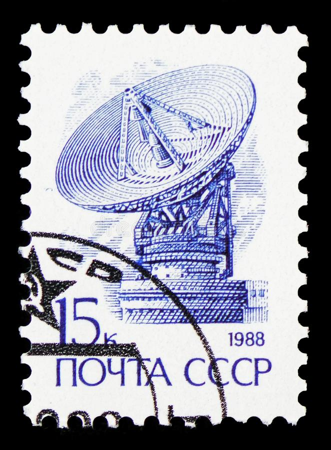 Dish aerial \'Orbit\', Definitive Issue No. 13 serie, circa 1988. MOSCOW, RUSSIA - FEBRUARY 20, 2019: A stamp printed in Soviet Union shows Dish aerial \'Orbit stock images
