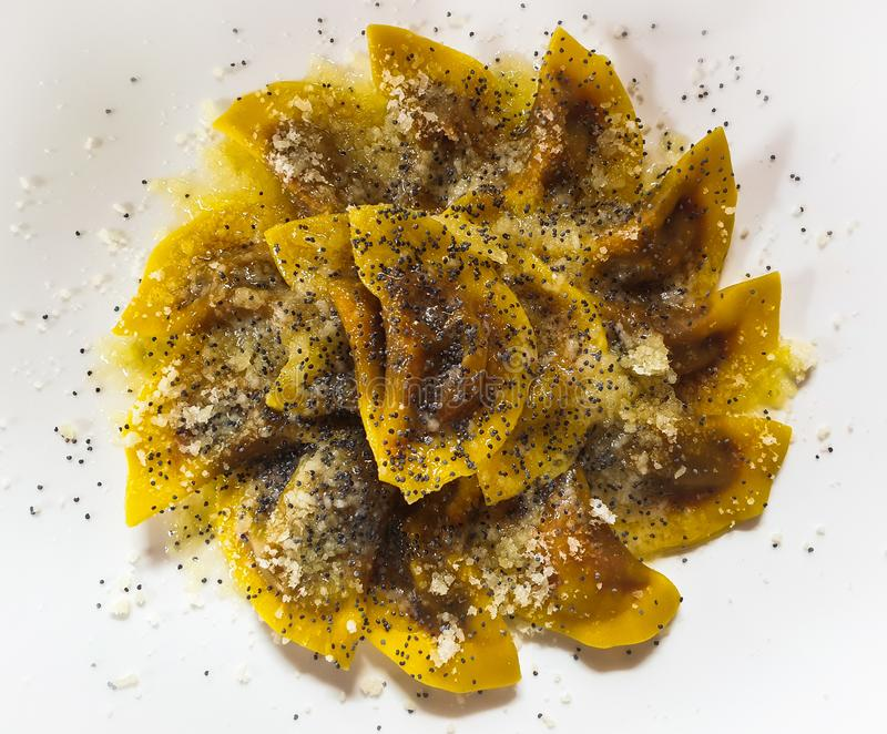 Dish of Casunziei, pasta filled with red turnip in Cortina D`Ampezzo, Dolomites, Italy. Top shot of a dish of Casunziei, pasta filled with red turnip in Cortina stock image