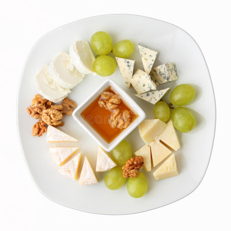 Dish of cheese with grapes royalty free stock photography