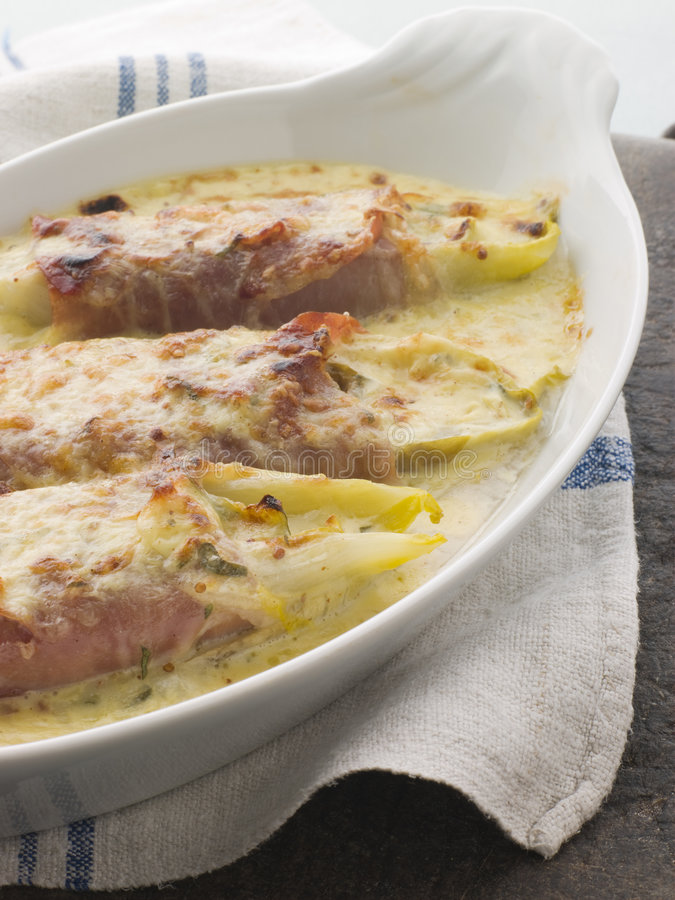 Dish of Chicory Gratin with Bacon stock image