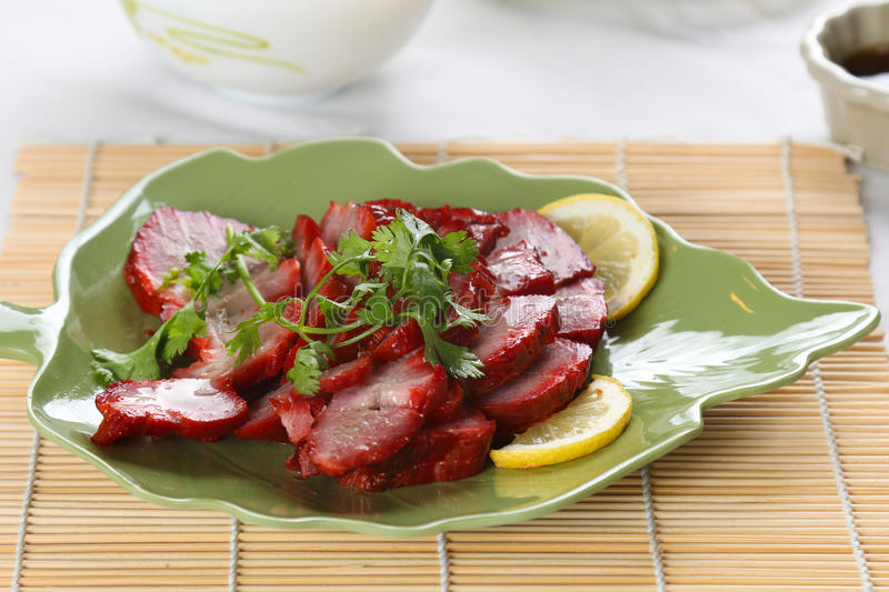 A dish of chinese roast pork stock image