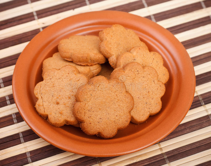 Dish of cinnamon cookies stock images
