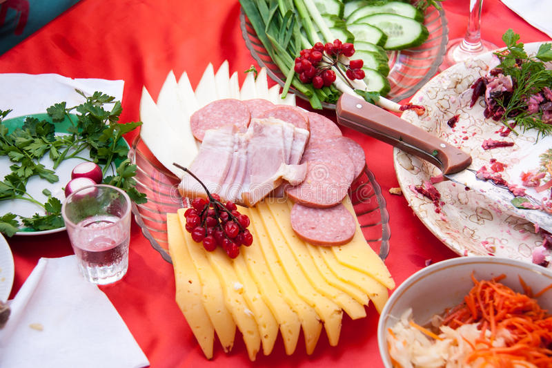 Dish with cutting sausage and cheese on a festive table stock photography