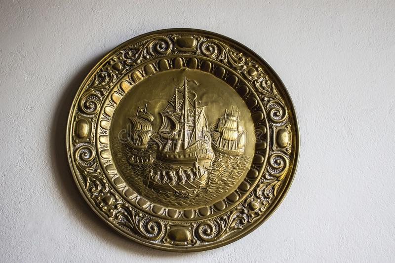 Dish with details. Decorative dish, illustrates the time of the great boat caravans, discovering new horizons stock photos
