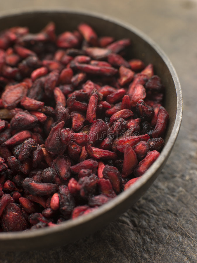 Dish of Dried Pomegranate Seeds royalty free stock image