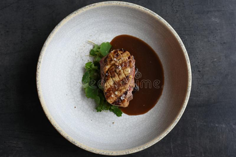 Dish in Fine Dining Restaurant. With  with a6 royalty free stock image