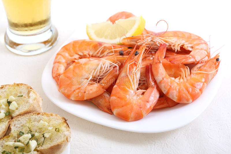 Dish of fresh boiled shrimps. On a table royalty free stock photos