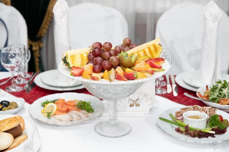 Dish with fresh fruit on the Banquet table in the restaurant stock images