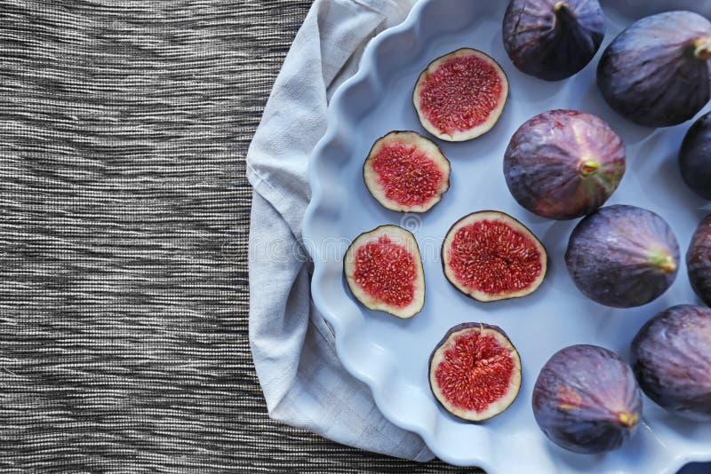 Dish with fresh ripe figs on napkin stock photos