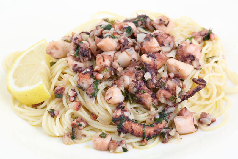 Dish of fried octopus with spaghetti stock photos