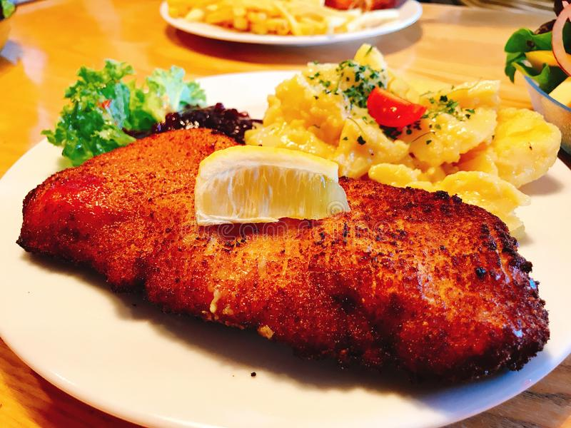 Dish of fried pork steak. Dish of fried pork steak served with mashed potato stock photos