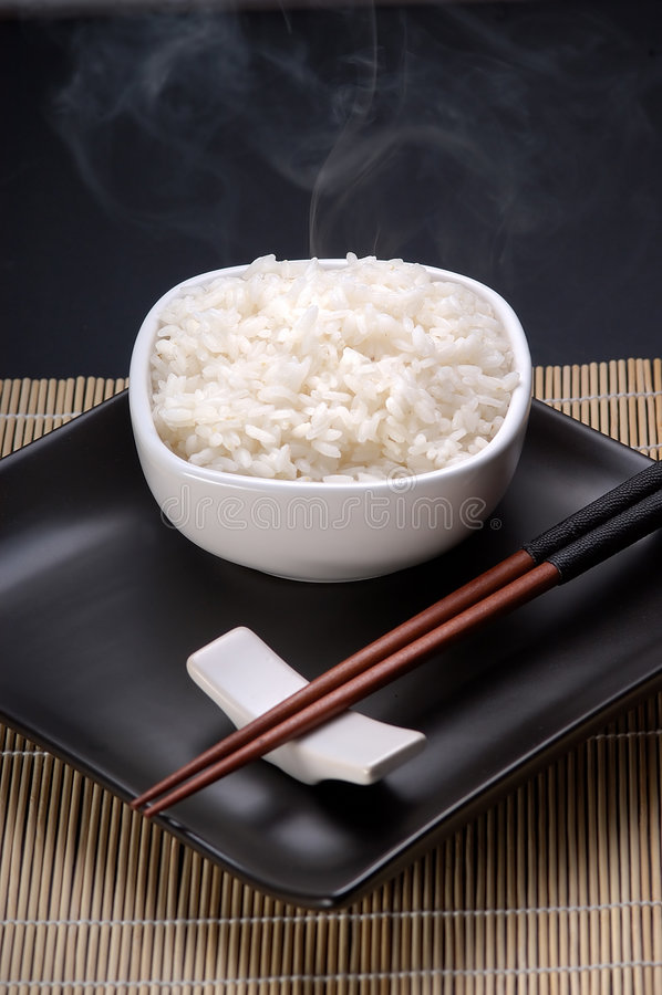 Dish full of plain rice royalty free stock photography