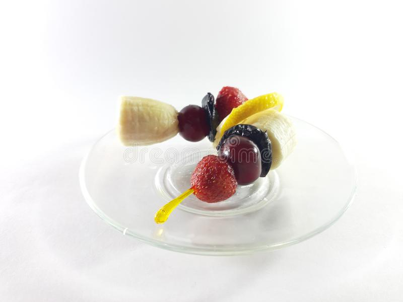 Dish for gourmet. Healthy food. Vegetarian foods on a transparent plate. Berries and fruits. Lemon and cherry for a snack. Photo. Dish for gourmet. Healthy food royalty free stock photo