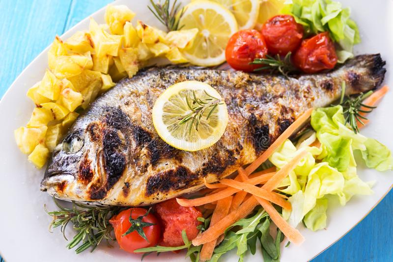 Grilled sea bass dish royalty free stock images