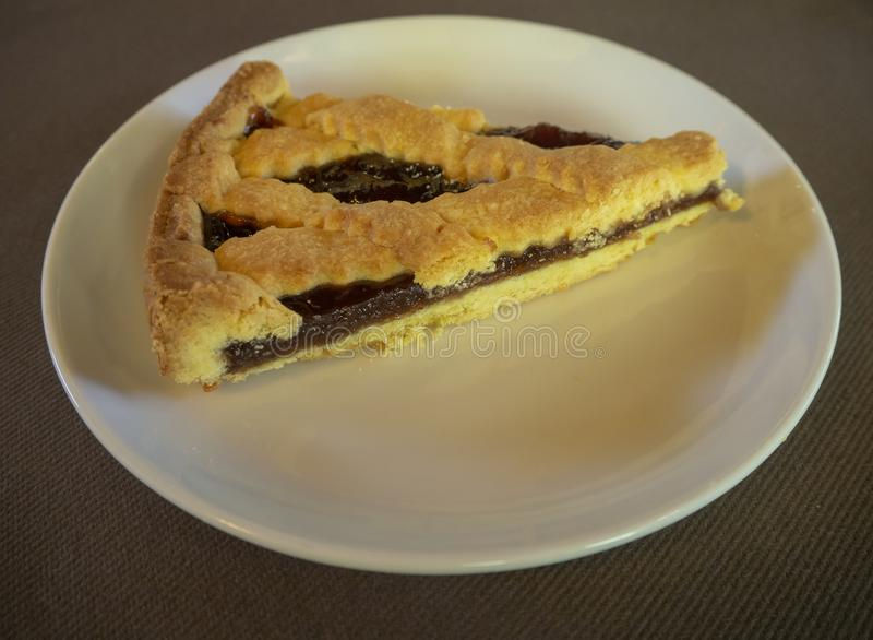 Dish with home made jam tart royalty free stock photography