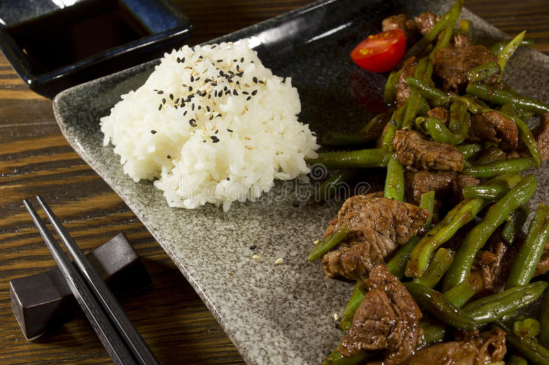 Dish of Japanese cuisine. Meat, rice and vegetables royalty free stock image