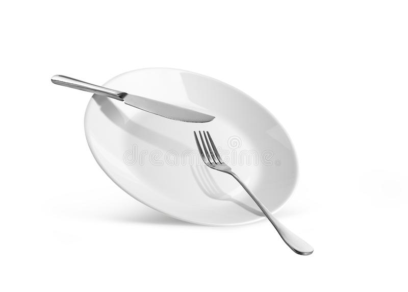 Dish with knife and fork. Isolated on white background stock photography
