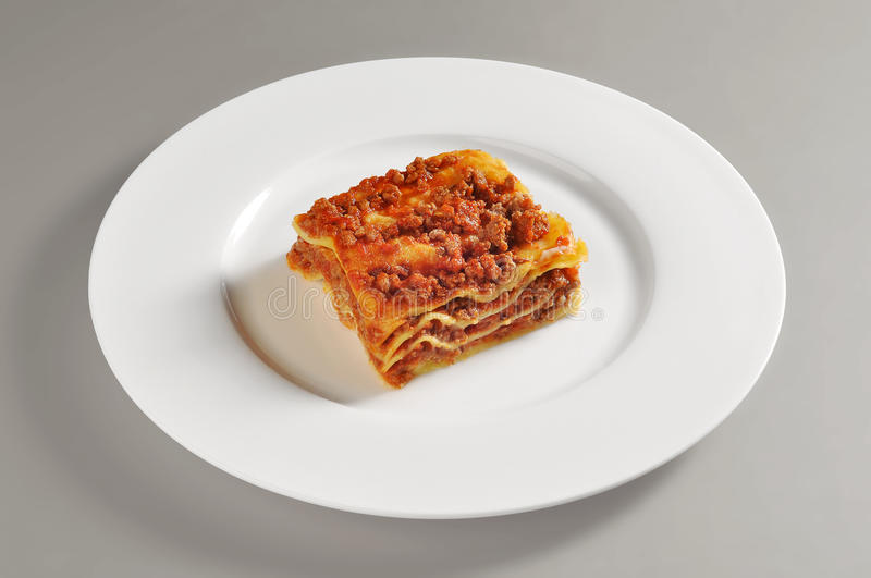 Dish with lasagna portion to meat stock image