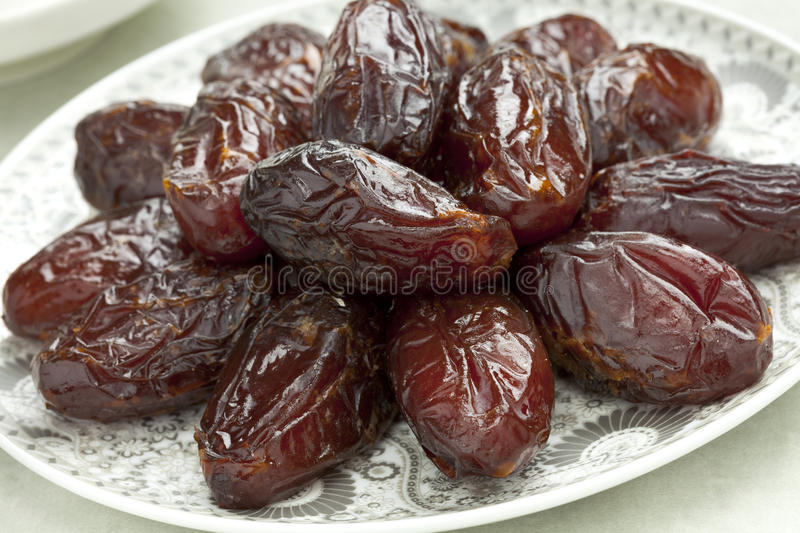 Dish with preserved Medjool dates. Dish with preserved ripe Medjool dates for festive occasions royalty free stock image