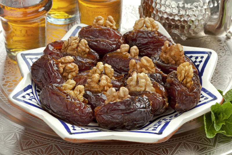 Dish with preserved Medjool dates. Dish with preserved ripe Medjool dates stuffed with walnuts for festive occasions royalty free stock photos