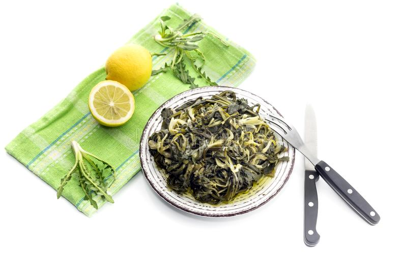 A dish of rare boiled grass `stamnagathi`Cichorium spinosum. Cretan cuisine. A dish of rare, wild, useful boiled grass `stamnagathi`Cichorium spinosum, that stock photos