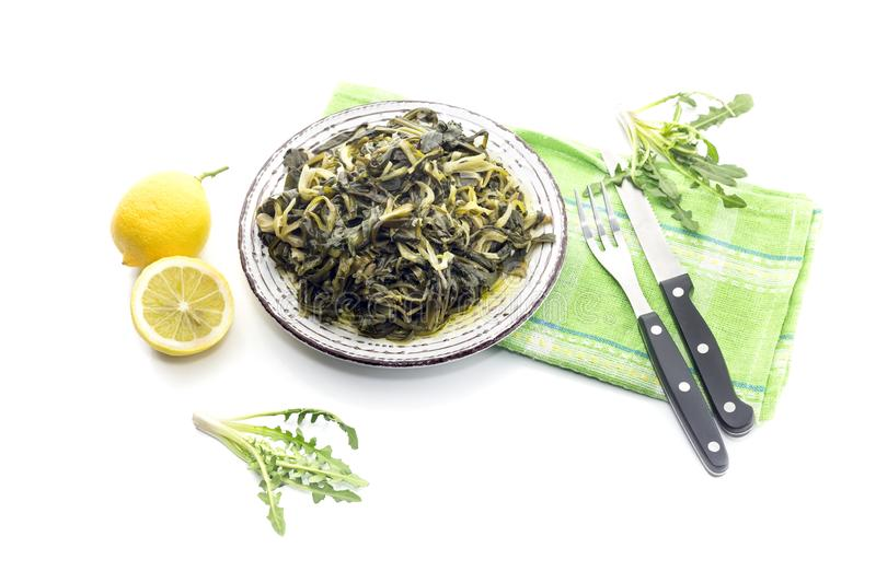 A dish of rare boiled grass `stamnagathi`Cichorium spinosum. Cretan cuisine. A dish of rare, wild, useful boiled grass `stamnagathi`Cichorium spinosum, that stock image