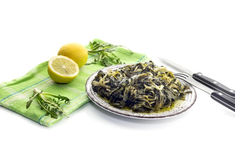 A dish of rare boiled grass `stamnagathi`Cichorium spinosum. Cretan cuisine. A dish of rare, wild, useful boiled grass `stamnagathi`Cichorium spinosum, that royalty free stock photography