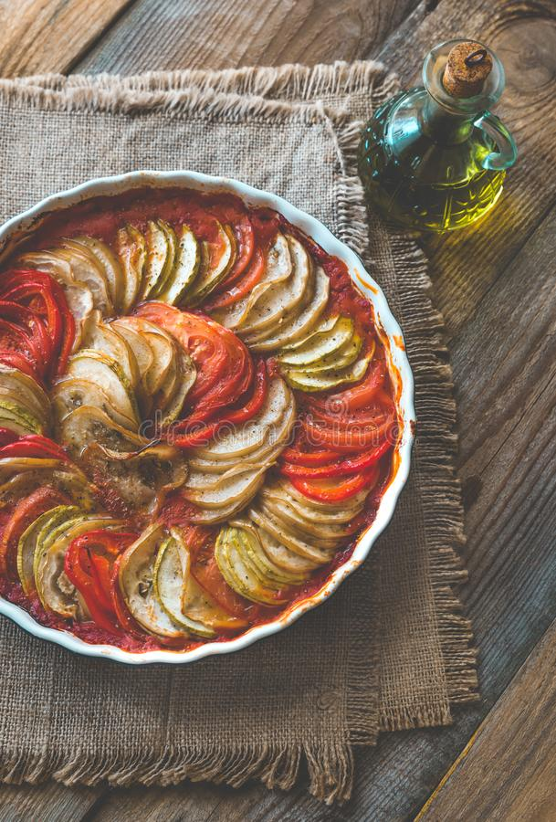 Dish of ratatouille. On the wooden table stock photos