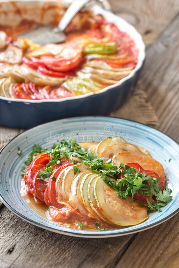 Dish of ratatouille. On the wooden table stock photography